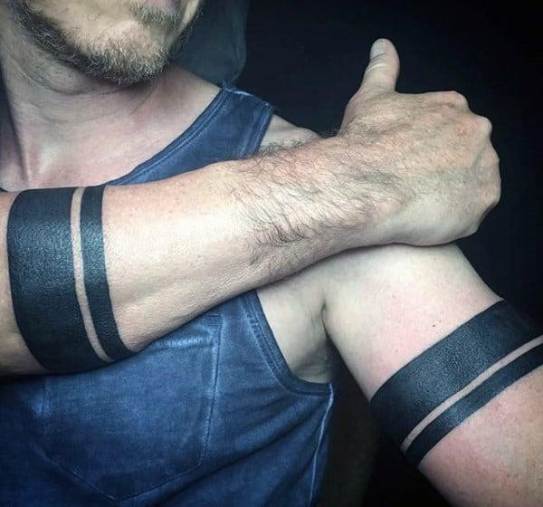 Solid Black Armband Tattoos On Man
