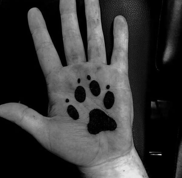 Solid Black Ink Dog Paw Palm Tattoo For Men