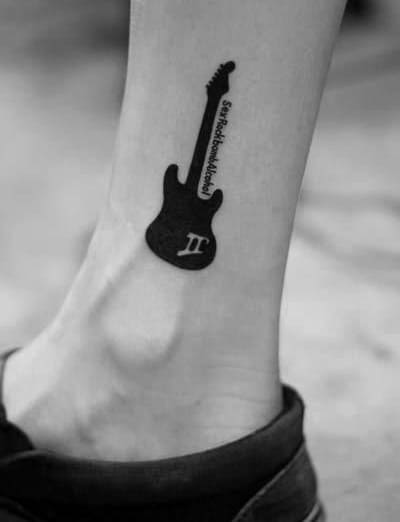 Solid Black Ink Guitar With Negative Space Music Note Guys Simple Leg Tattoo