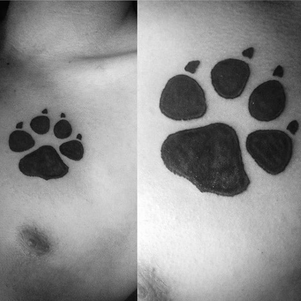 Solid Black Ink Guys Wolf Paw Chest Tattoos