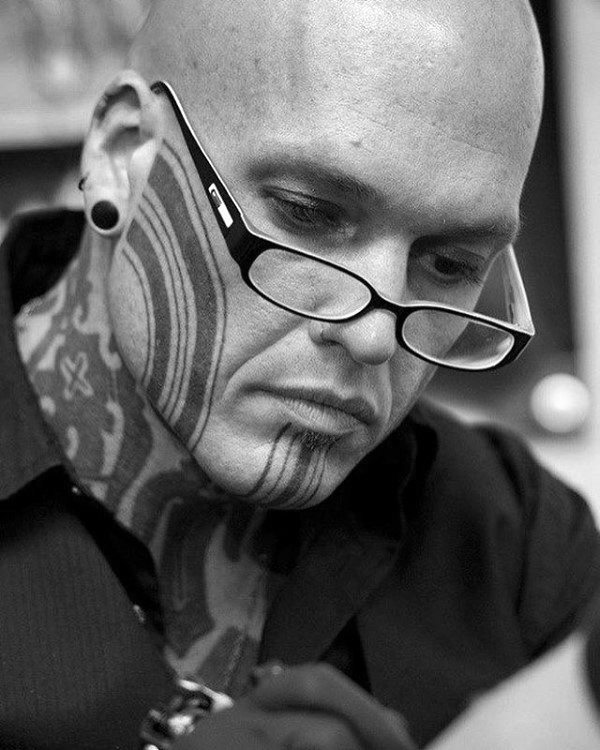 Solid Black Ink Lines Male Face Tattoo Ideas