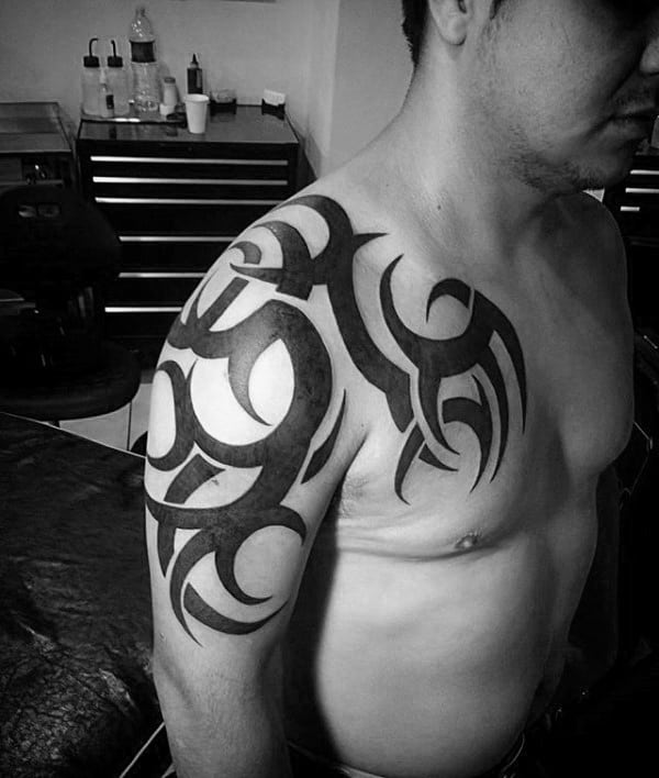 Solid Black Ink Tribal Shoulder Male Tattoo Ideas