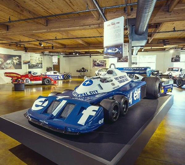 Spacious Wood Ceiling Dream Garage With Race Vehicles