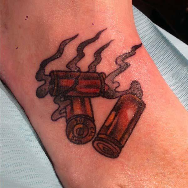 Spent Bullet Cartridges Tattoos For Men On Foot