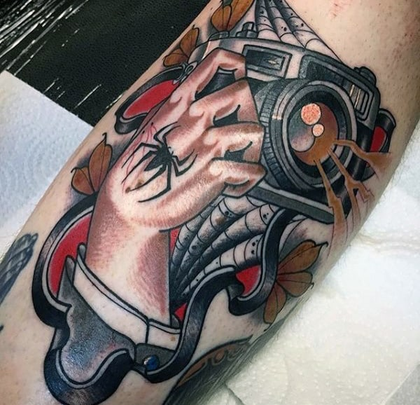 Spider Crawling On Hand Holding Camera Tattoo Male Arms