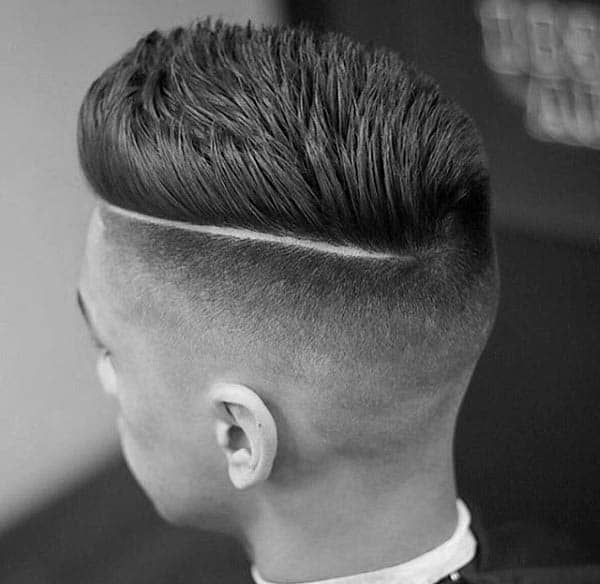 Spiky Hard Part Mens Hairstyle With Low Fade On Sides