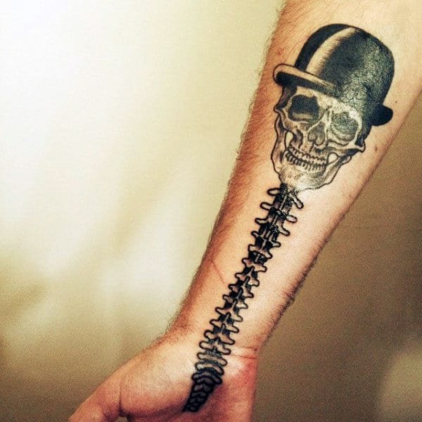 Spinal Cord With Skull Wearing Top Hat Tattoo For Guys On Wrist And Hand