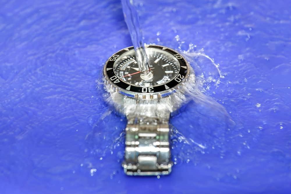 splashing water over waterproof hand watch