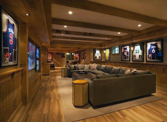 Sports Theme Home Basement With Brown Hardwood Flooring