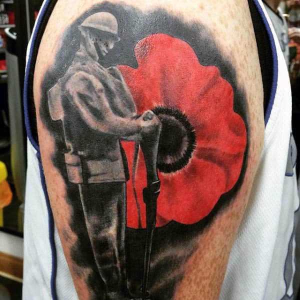 Standing Solider Red Poppy Tattoo Upper Arm For Guys