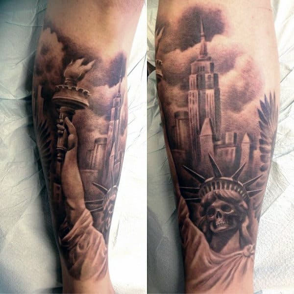 Statue Of Liberty Empire State Building Tattoo On Mans Forearm