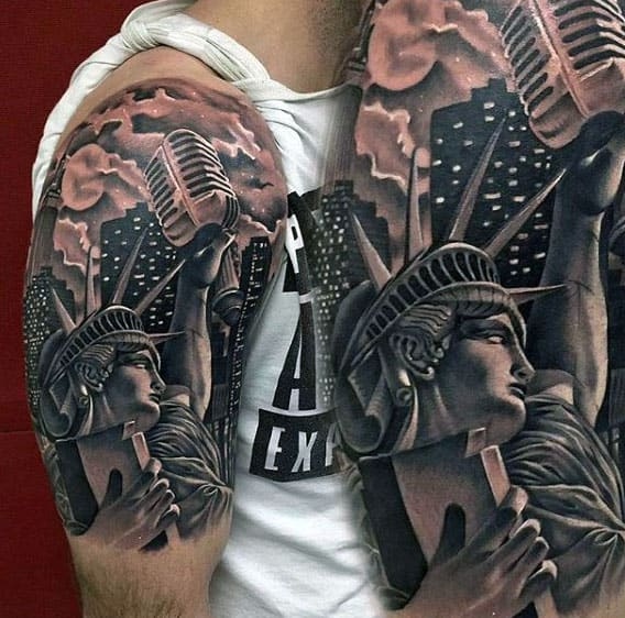 Statue Of Liberty Holding Microphone Tattoo Guys Arms