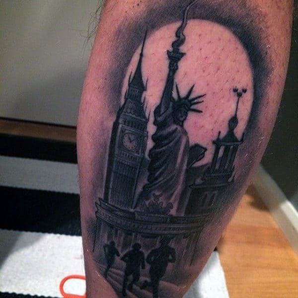 Statue Of Liberty Runners Tattoo On Male Leg