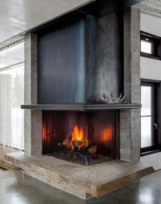 Steel And Concrete Corner Fireplace Design