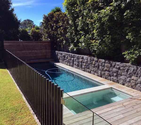 Steel With Glass Panels And Rock Remarkable Ideas For Pool Fence