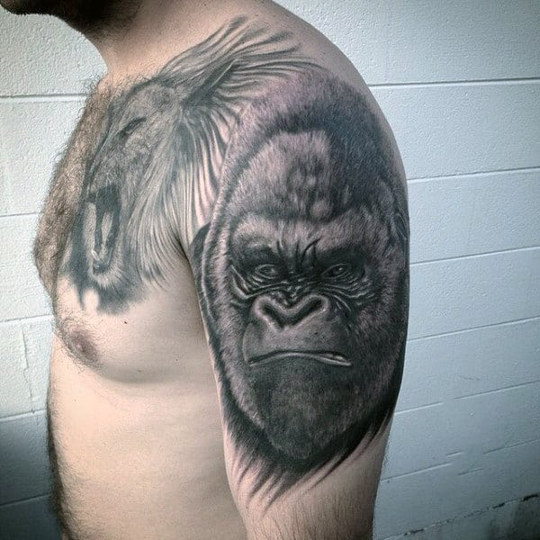 Stern Looking Gorilla Tattoo On Mans Upper Arm