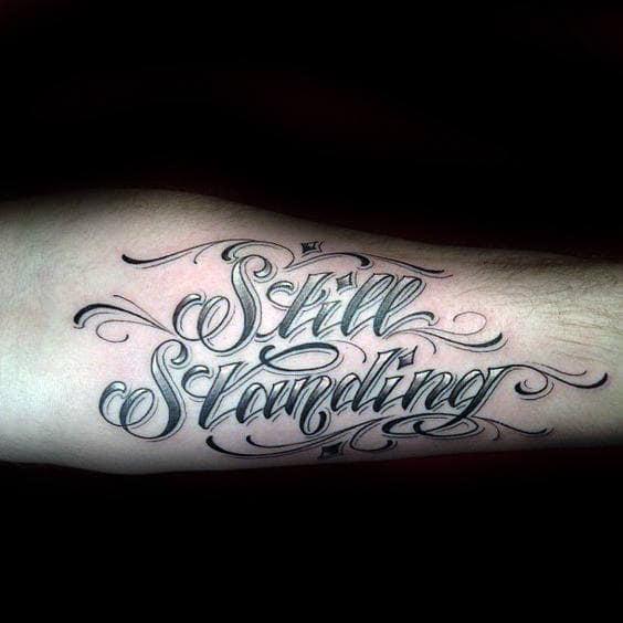Still Standing Mens Strength Lettering Tattoo Design Ideas