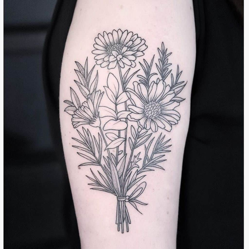 Upper arm tattoo black and grey stipple shading line work daisy bouquet