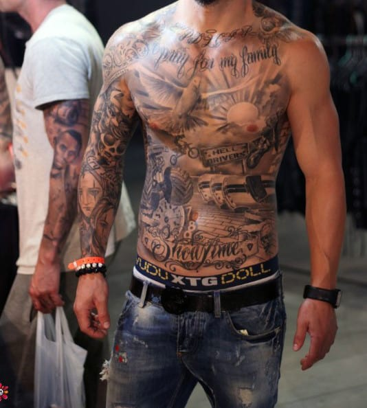 Stomach And Dove Chest Tattoo On Man