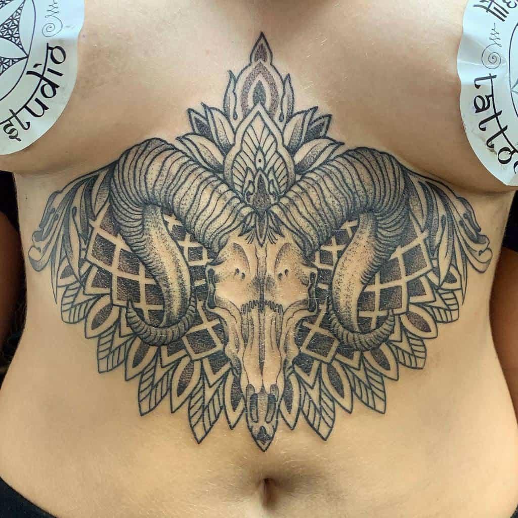 stomach ram skull tattoo josswilderstattoo