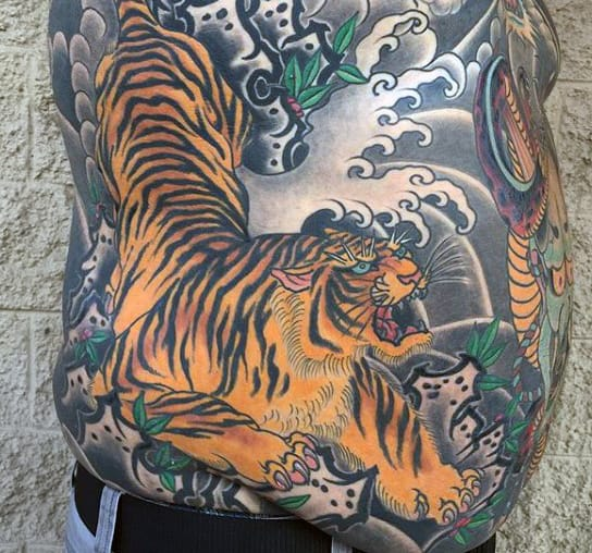 Tiger stripes tattoo on stomach