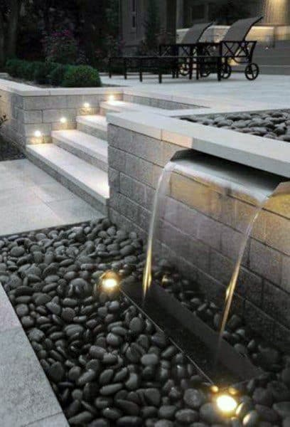 Stone And Black Pebble Backyard Waterfalls