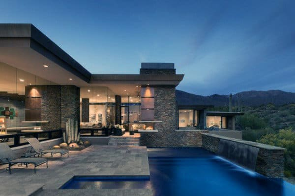 Stone Home Swimming Pool With Waterfall Wall