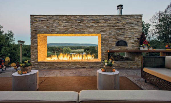 Stone Wall Outdoor Fireplace With Huge Opening On Patio