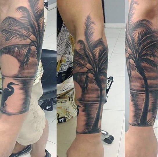 Stork And Palm Tree Tattoo On Lower Arms For Men