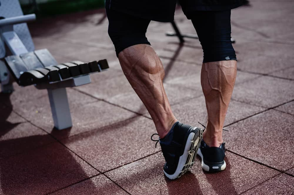 strong athlete legs of man in sneakers on outdoor training workout