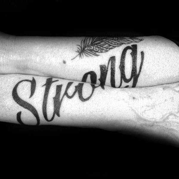 Strong Lettering Tattoo Across Both Forearms Male Strength Tattoo