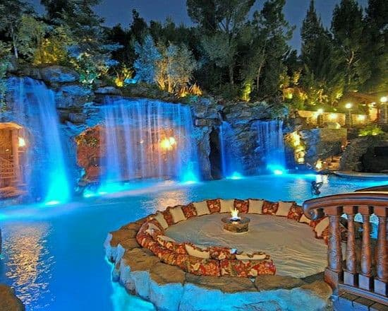 Stunning Backyard Swimming Pool Retreat Ideas With Waterfalls And Firepit
