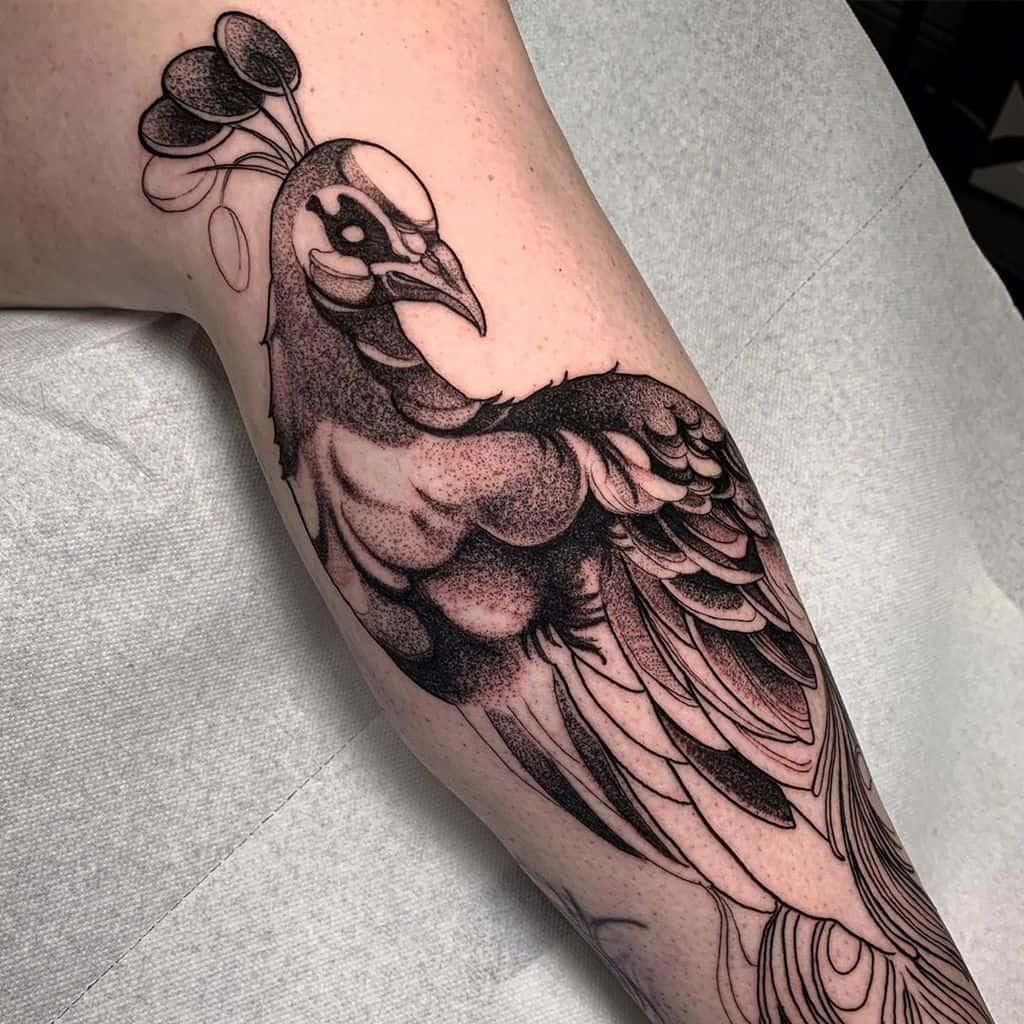 Superbe tatouage de paon