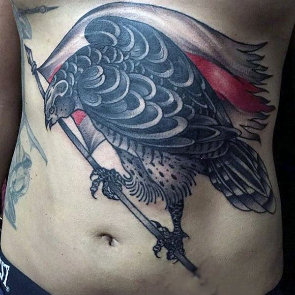 Stylized Hawk Wthi Tattered Flag Tattooon Mans Stomach