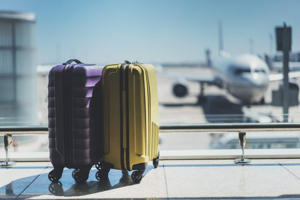 traveler suitcases in airport departure lounge waiting area