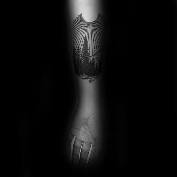 Sun Rays With Tree Woods Mens Small Forearm Tattoo Design Ideas