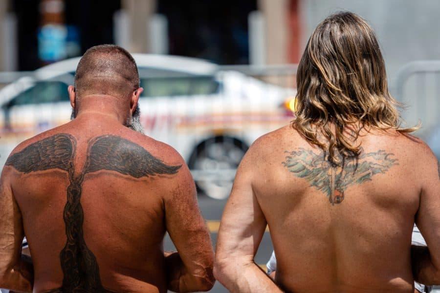 Sunburned Guys Tattooed Skin