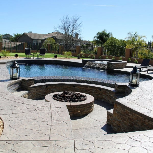 Sunken Firepit Pool With Stamped Concrete Flooring Cool Backyard Ideas