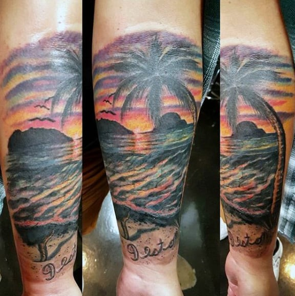 Sunset Tattoo On Mans Arm With Dramatic Color And Palm Tree