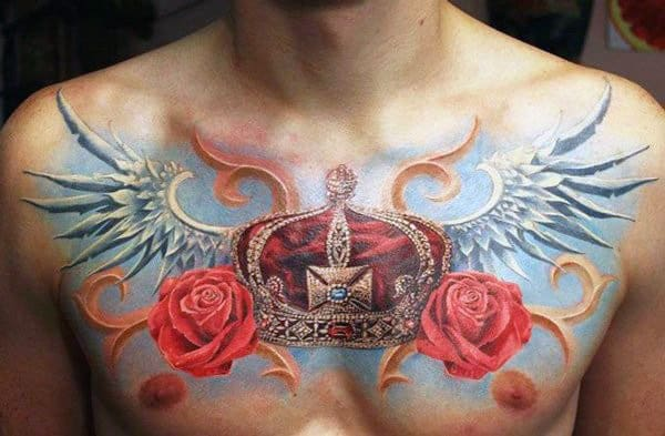 Superb Red Crown With Blue Wings Tattoo On Chest For Men
