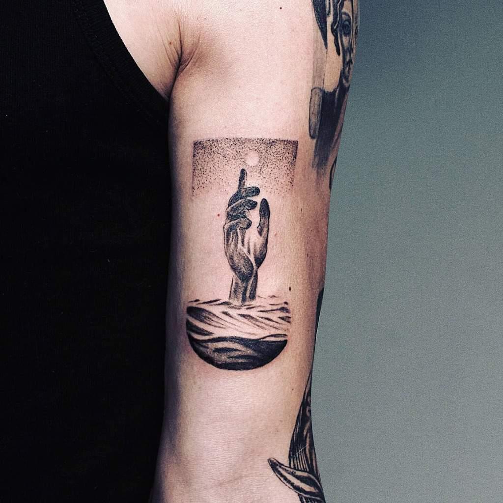 surrealism-hand-modern-arm-black-white-ocean-tattoo-rabbithole.tattoo