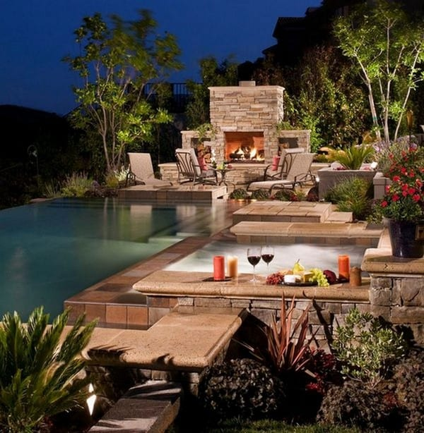 outdoor swimming pool with brick fireplace