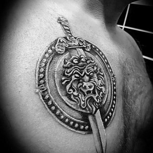 Sword With Shield Male Chest Tattoo