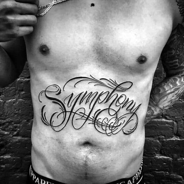 Symphony Words Script Lower Stomach Tattoos For Men