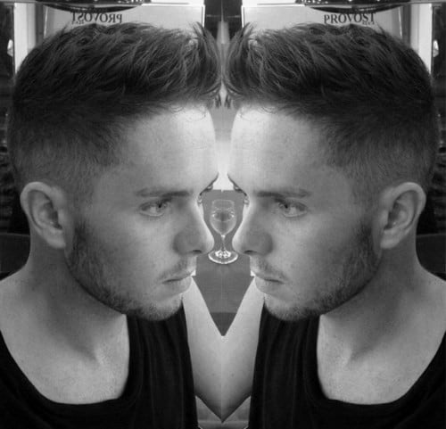 Taper Fade Faux Hawk Hairstyle For Males