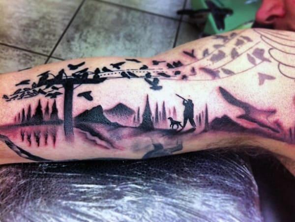 Tattoo Hunter On Man's Bicep