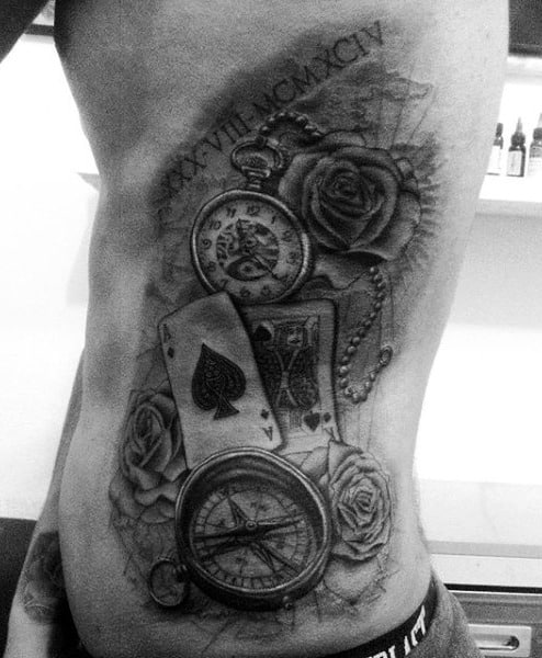 Black Tattoo Of A Compass On Male