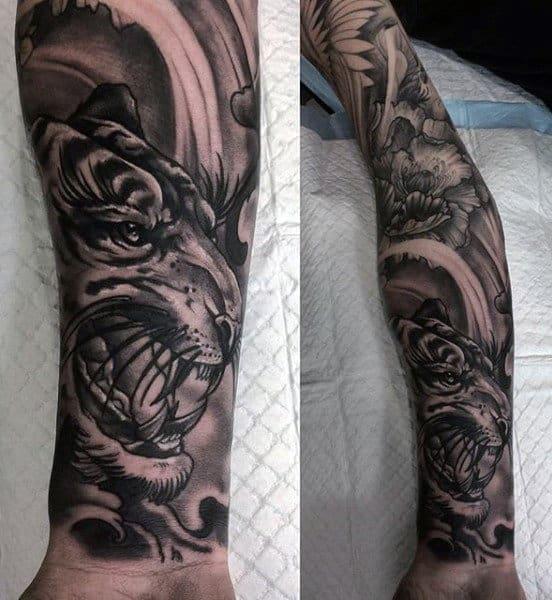 Tattoo Of A Tiger On Man