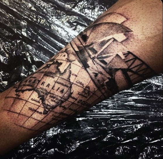 50 world map tattoo designs for men adventure the globe tattoo of australia map on mans forearm gumiabroncs Images