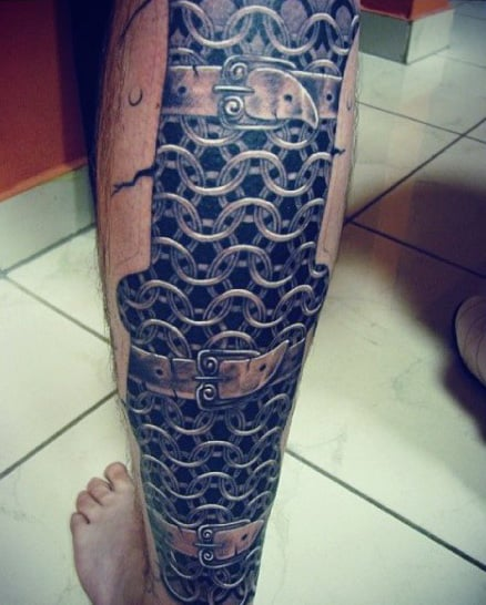 Tattoo Of Chains On Man On Legs